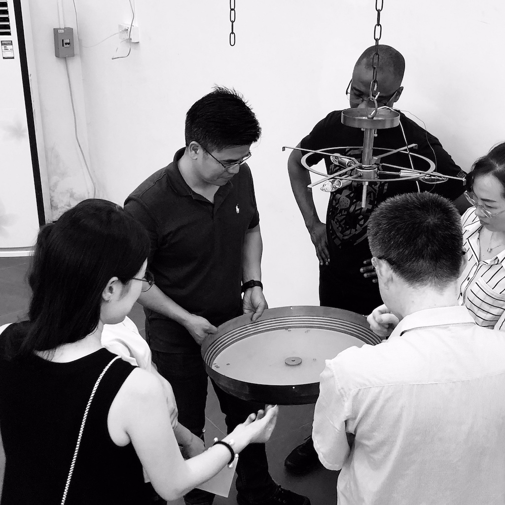 As the design team is at work on product design on the ground in China, Clarence Mallari checks out a fixture.