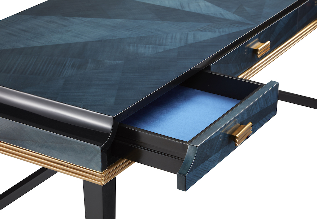 The drawers of the Kallista are lined with a vibrant blue fabric.